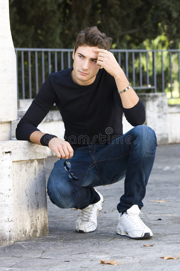 Fashion guy cool model outdoor royalty free stock photos