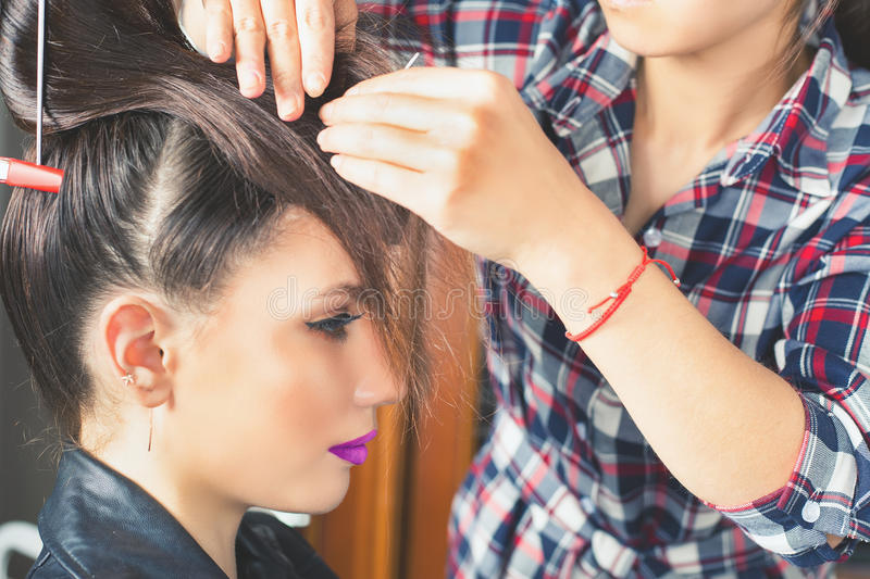 Fashion hairstyle. Make up. Hair saloon. Beautiful young women at beauty salon. Fashion hairstyle. Make up. Hair saloon. Stylish haircut, styling, fixing royalty free stock photos