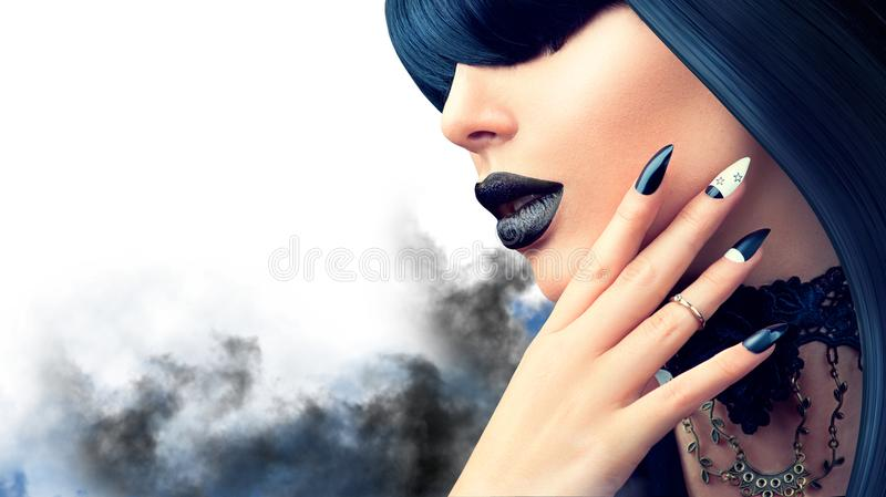 Fashion Halloween model girl with gothic black hairstyle, makeup and manicure stock photography
