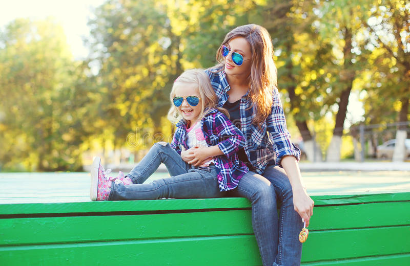 Fashion happy mother and child daughter having fun royalty free stock photography