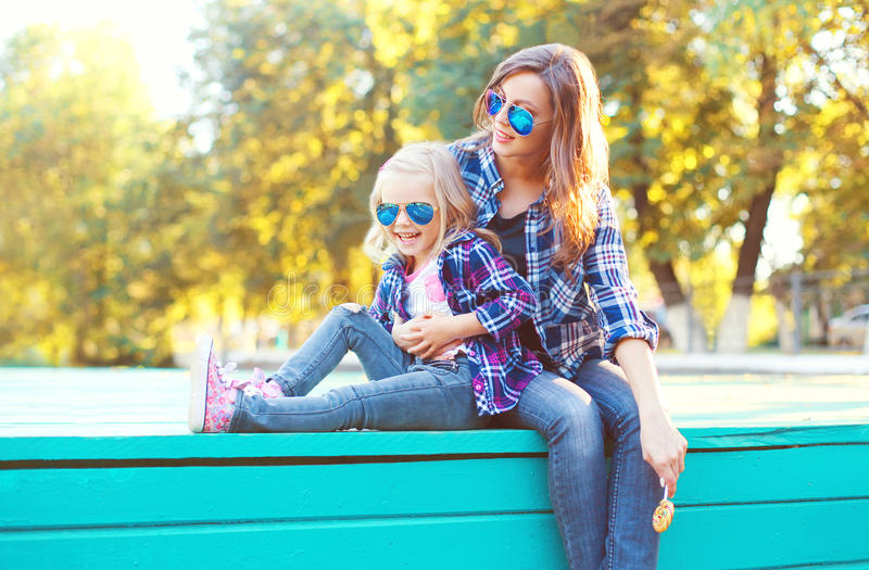 Fashion happy mother with child daughter having fun together stock photo