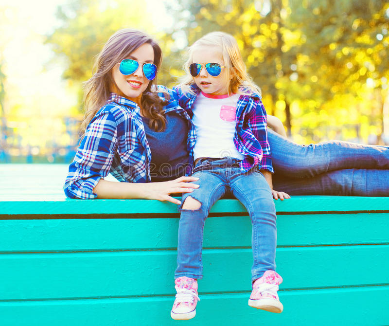 Fashion happy young mother and child daughter having fun stock photo