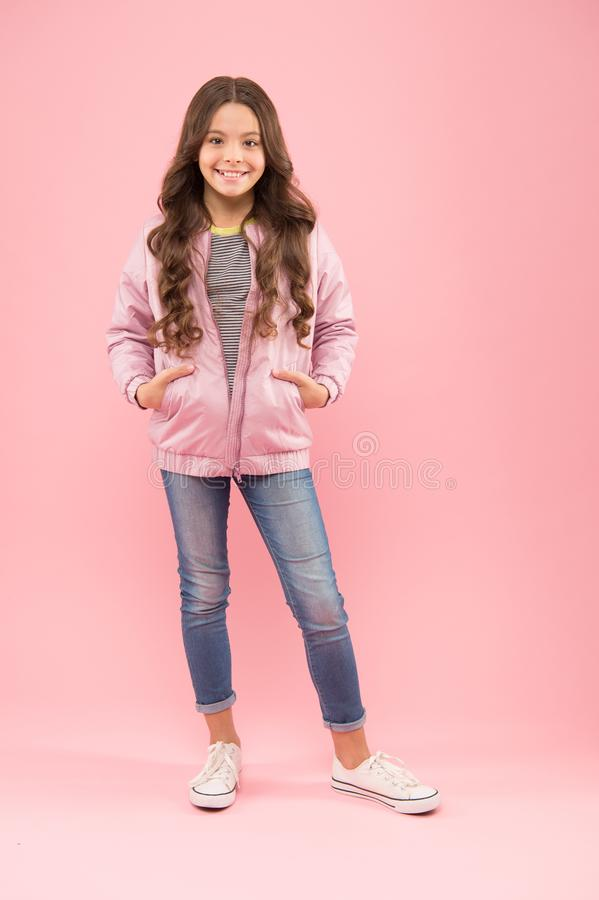 Fashion is her life. Autumn look of small fashion model. Happy girl in cozy fashion outfit on pink background. Cold. Weather fashion for kids. Gorgeous and royalty free stock images