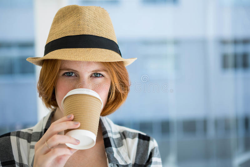 Fashion hipster having a coffee royalty free stock photos