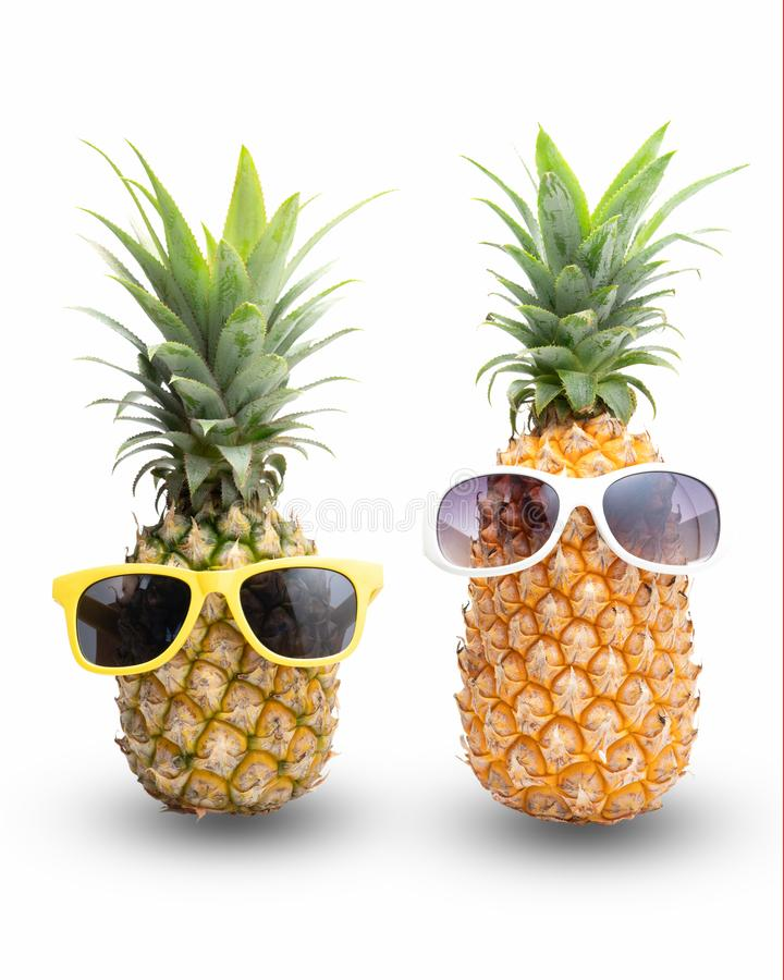 Fashion hipster pineapple, Bright summer color, Tropical fruit with sunglasses, Creative art concept, Minimal style. Hot beach vibes on a white background royalty free stock image