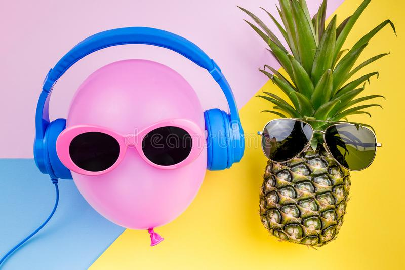 Fashion Hipster Pineapple and pink air balloon on colorful background, Bright Summer Color, Tropical Fruit with stock image