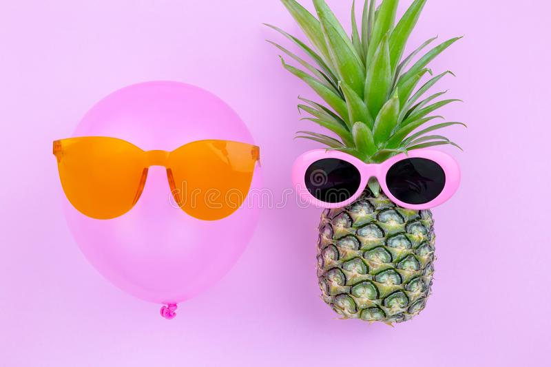 Fashion Hipster Pineapple and pink air balloon on pink color background, Bright Summer Color, Tropical Fruit with royalty free stock images