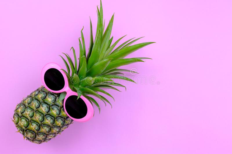 Fashion Hipster Pineapple on pink color background, Bright Summer Color, Tropical Fruit with Sunglasses, Creative Art concept. Mi royalty free stock photos