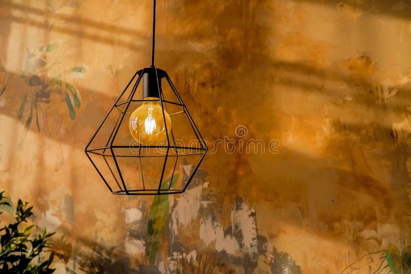 Fashion and hitech lamp in modern style. Warm tone light bulb lamp. Lamps in coffee shop and boutique. Edison hanging. Fashion and hitech lamp in modern style royalty free stock photography