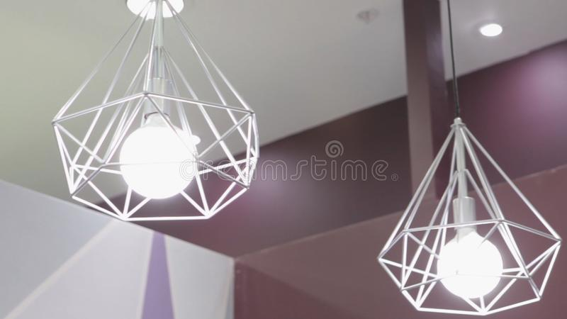 Fashion and hitech lamp in modern style. Warm tone light bulb lamp. Lamps in coffee shop and boutique. Fshion. HD stock photos