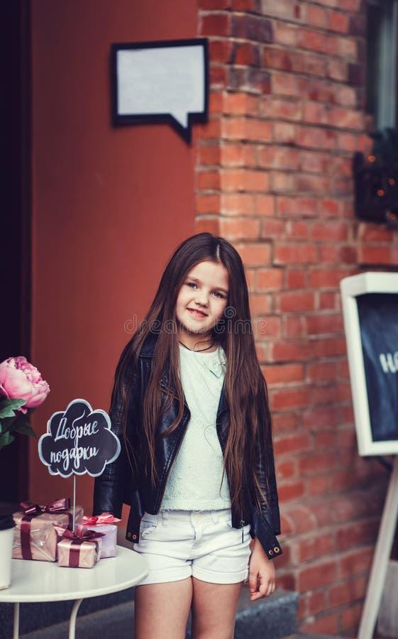 Stylish little girl child wearing a leather jacket stock photos