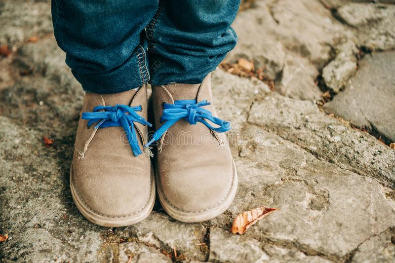 Fashion lace shoes on kid`s feet royalty free stock photography