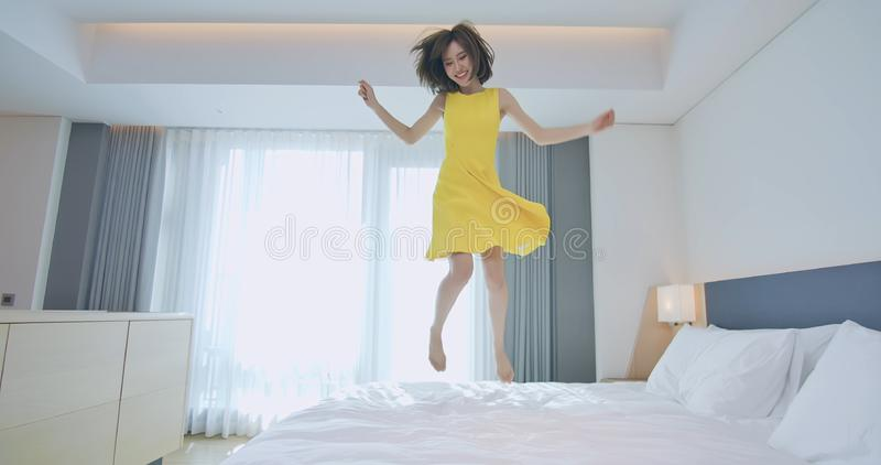 Fashion lady jump on bed stock photography