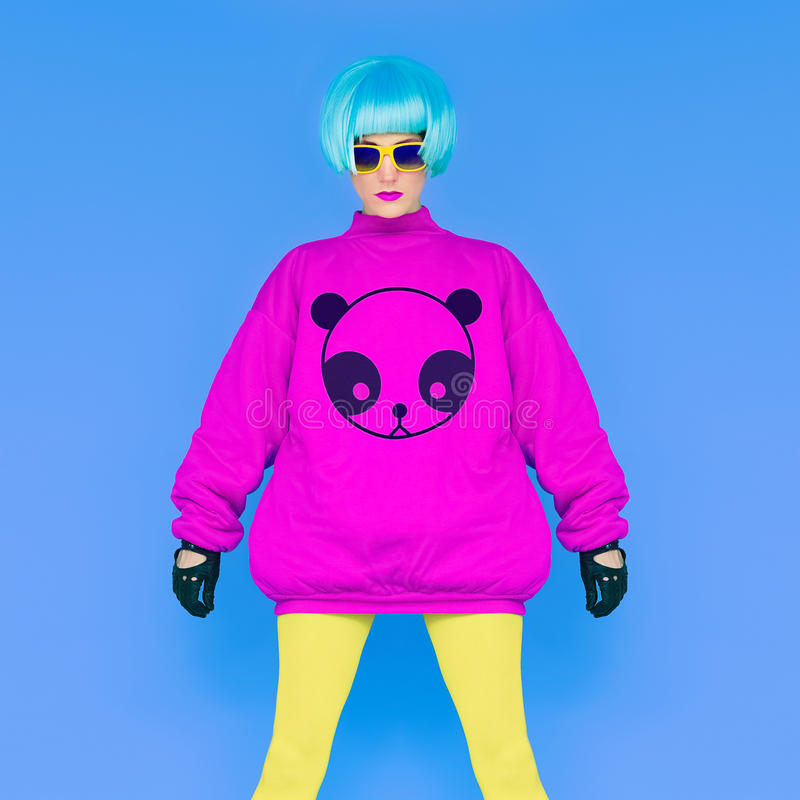 Fashion Lady loves panda. Funny photo. Girl in a bright wig on a royalty free stock photography