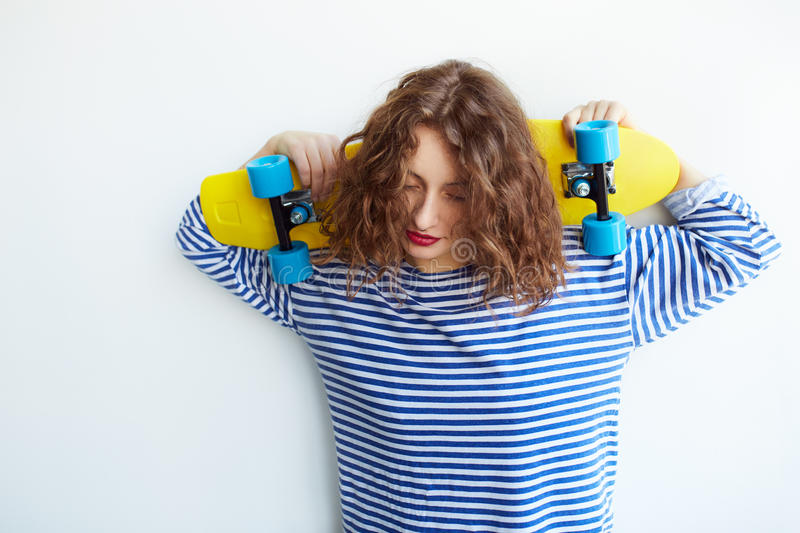Fashion lifestyle, Beautiful young woman with skateboard royalty free stock photos