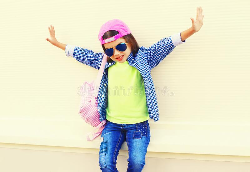 Fashion little girl child in baseball cap having fun in city on white royalty free stock photos