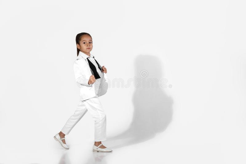 Fashion little girl model in a white suit and bow tie stock photos