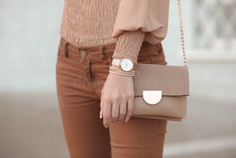 Fashion look autumn woman outfit. Stylish women`s beige handbag. royalty free stock photo