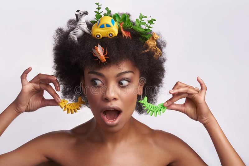 Shocked young ethnic woman in odd style royalty free stock photo