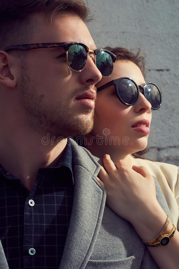 Fashion looking couple in the city stock photo