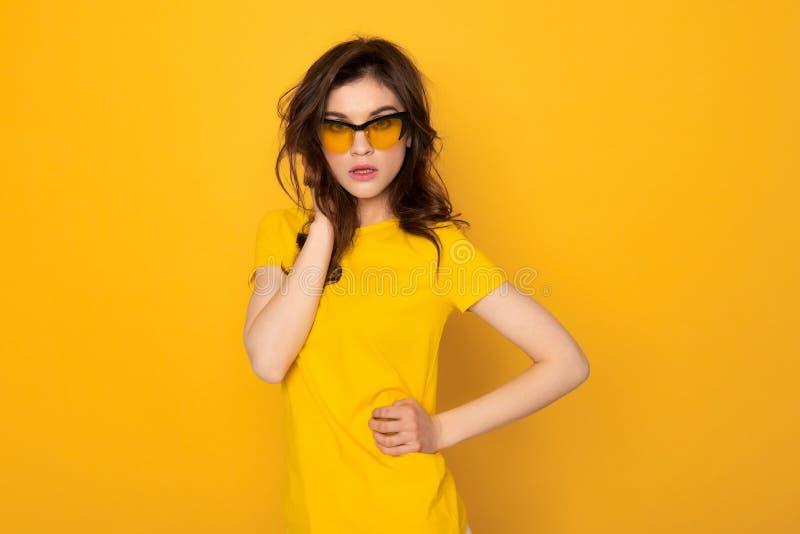 Fashion looking stylish girl isolated on yellow stock images