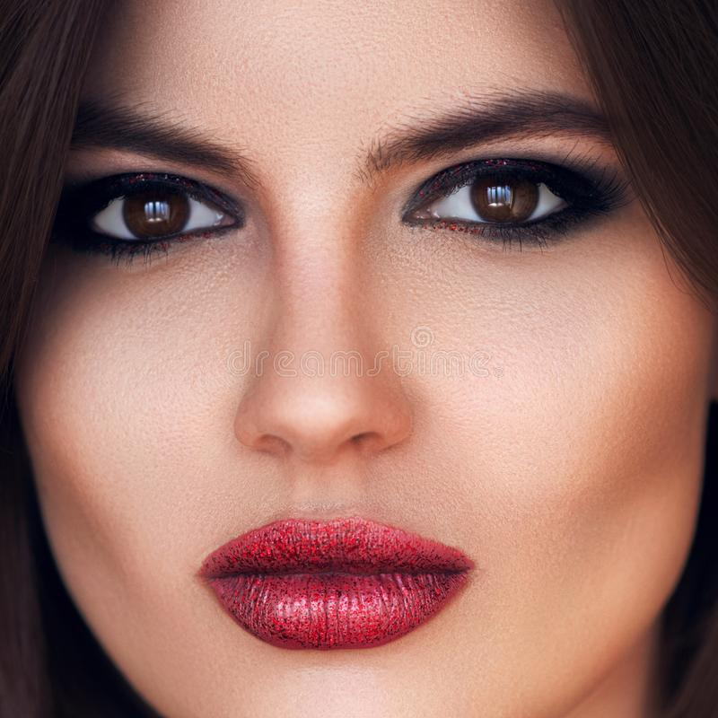 Fashion luxury woman makeup. Dark red lips and black eye shadow pigment. Fashion, beauty and cosmetics. Sexy lady makeup for party stock photos