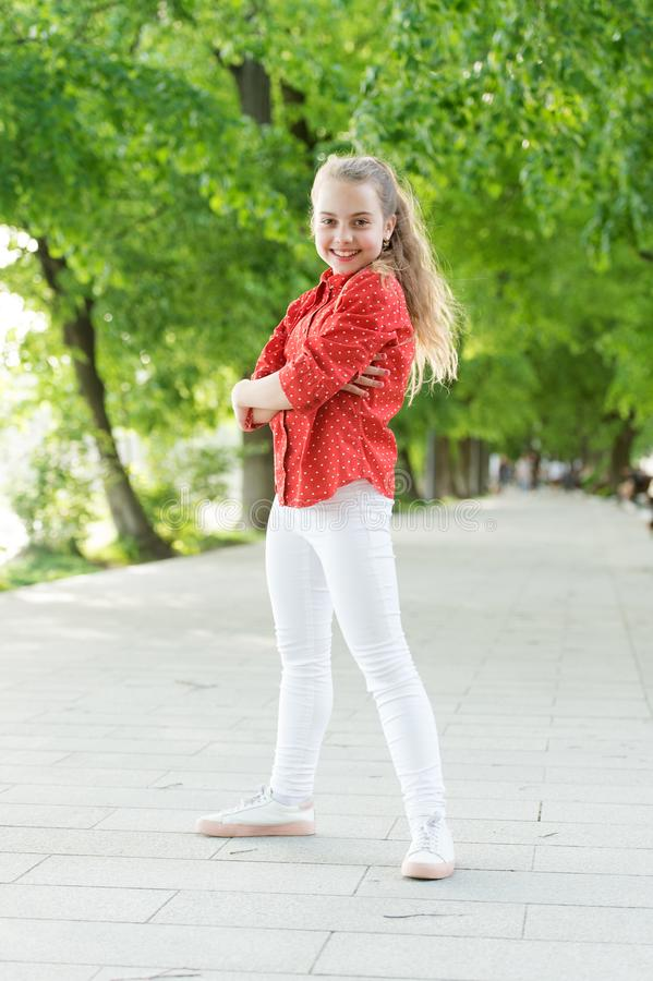 Fashion really makes her stand out. Fashion look of small vogue model. Adorable girl in fashion wear on summer day stock photography