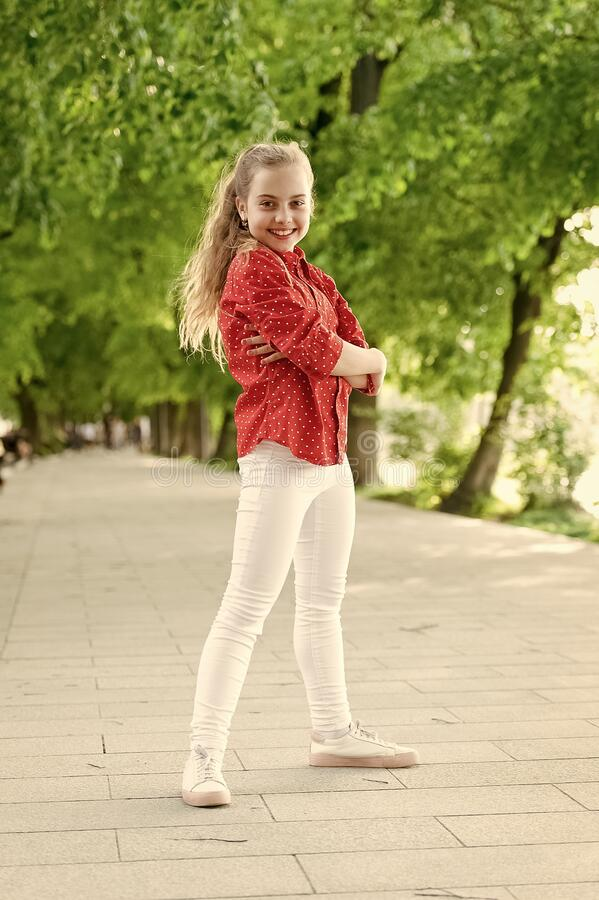 Fashion really makes her stand out. Fashion look of small vogue model. Adorable girl in fashion wear on summer day royalty free stock photos