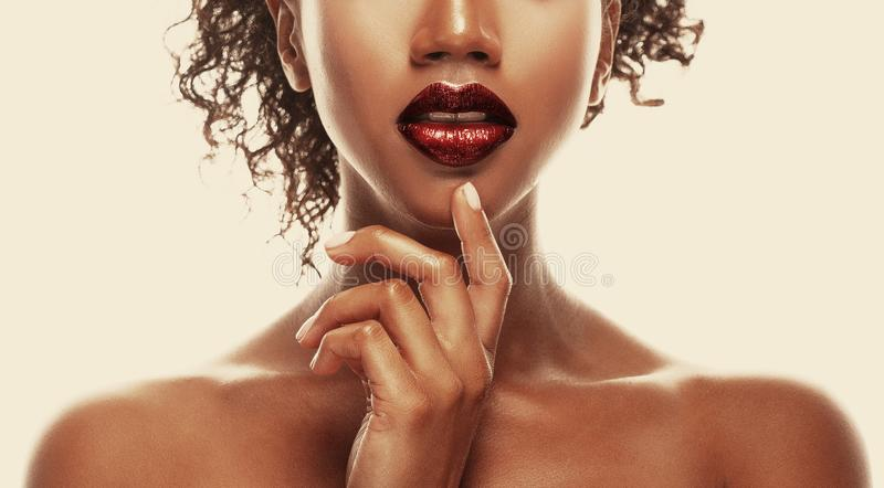 Fashion makeup. Close-up of lips African American young woman. royalty free stock photo