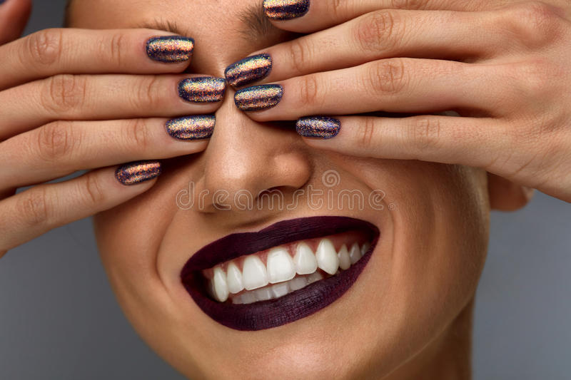 Fashion Makeup. Woman With Dark Nails, Lipstick And White Smile royalty free stock images