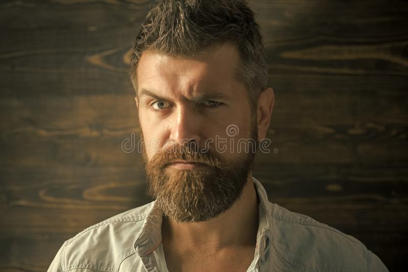 Fashion and male beauty of graying man. Barber and hairdresser salon. Haircut of bearded man, archaism. Man with beard. And mustache on wooden background royalty free stock photos