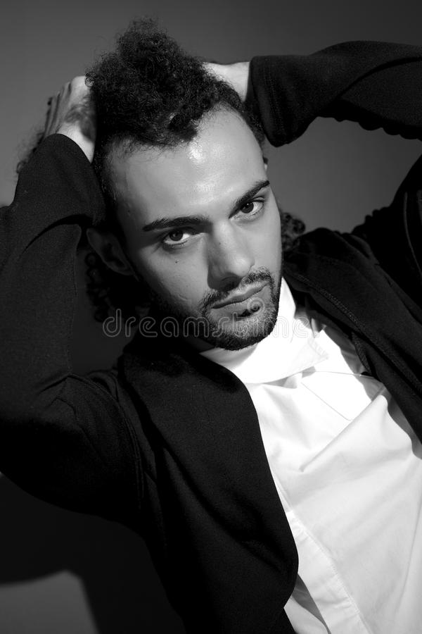 Fashion male model holding curly hair black and white portrait royalty free stock images