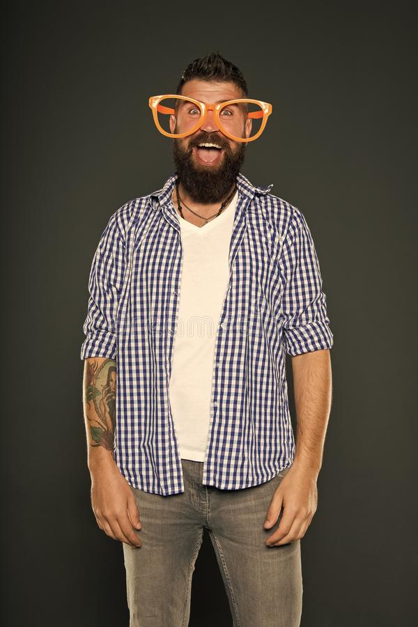 Fashion man with beard. Playful guy enjoying party. Funny glasses accessory. Entertaining himself. Only fun on my mind stock image