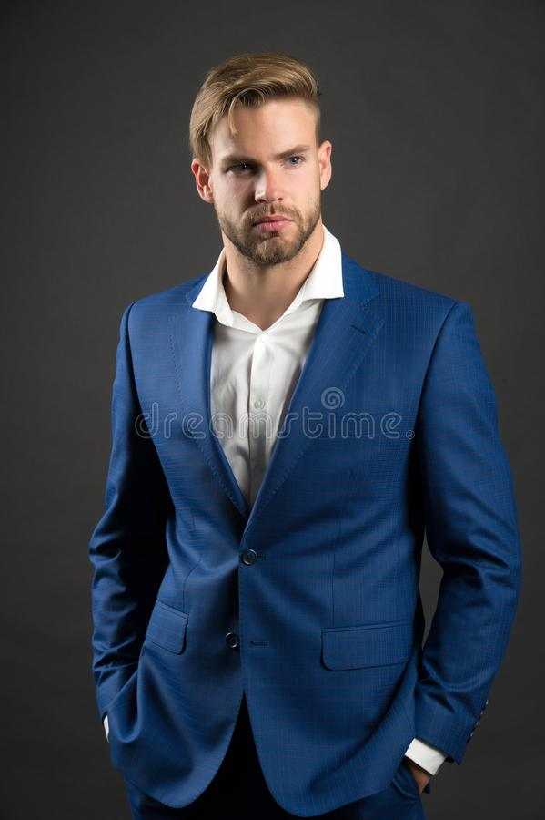 Fashion man in blue suit jacket and shirt. Businessman with bearded face and stylish hair. Manager in fashionable formal outfit. D stock photography