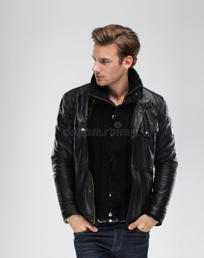 Fashion man, model leather jacket, gray background royalty free stock photos
