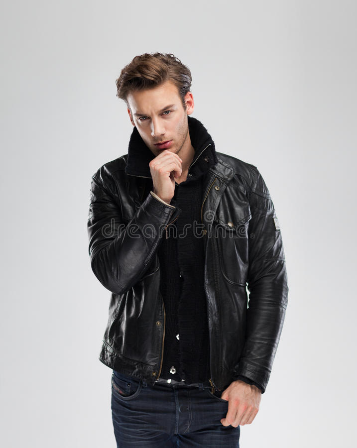 Fashion man, model leather jacket, gray background stock photos