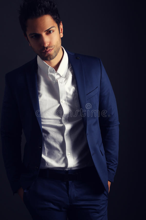 Fashion man model wearing a blue suit royalty free stock photos