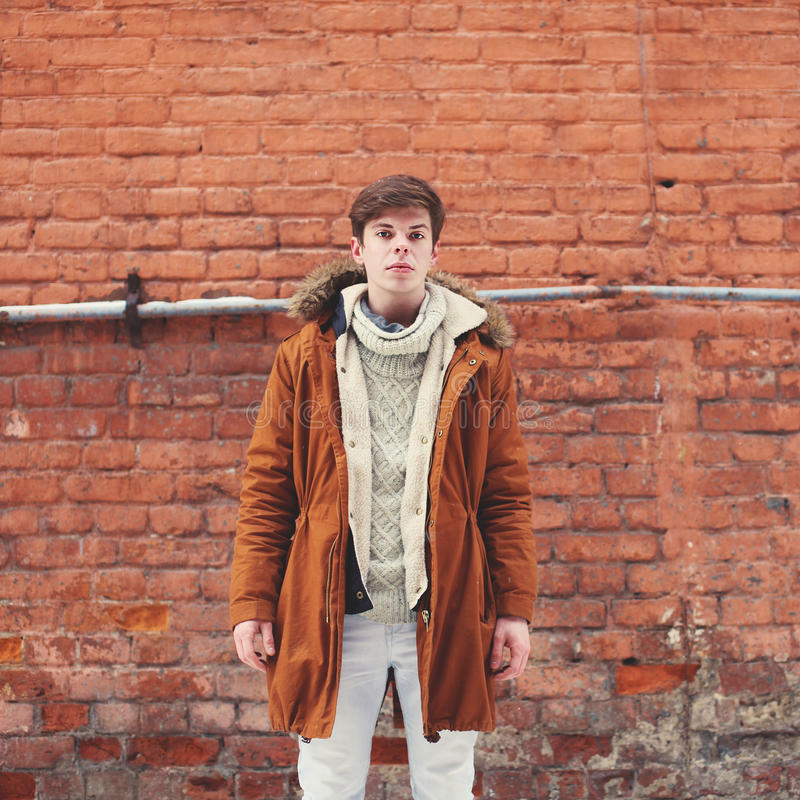 Fashion man outdoors in urban style. On against a brick wall royalty free stock photos