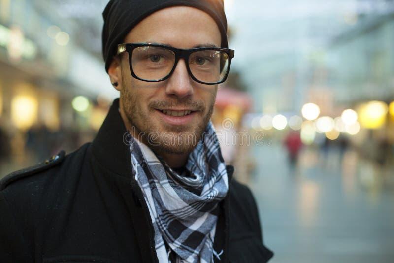 Fashion man on street, blurred city background royalty free stock photo