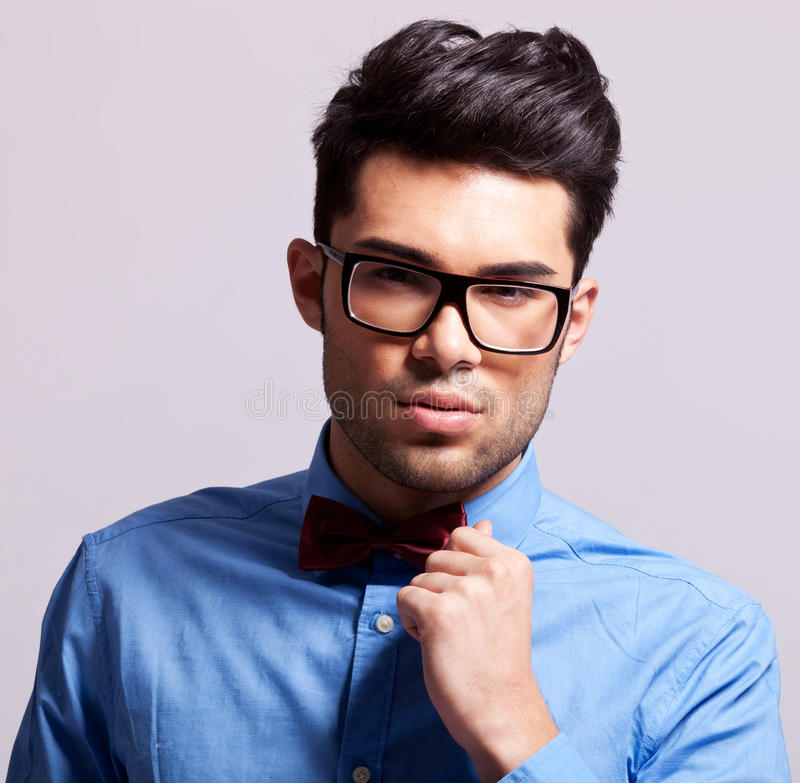 Download Fashion Man Wearing Bow Tie And Glasses Stock Photo - Image of grey, cool: 26496574