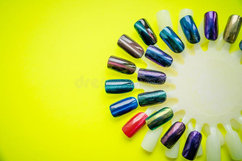 Fashion manicure. Shiny gel lacquer. Spring style. color of Polish for manicure. design for nails. testers nail Polish stock images
