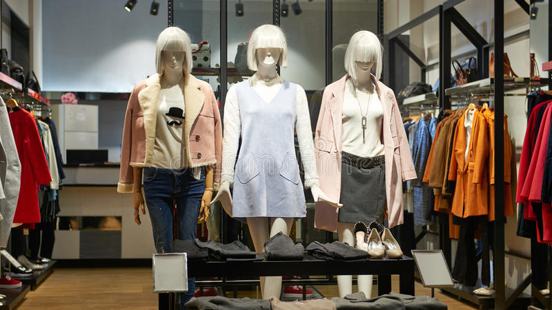 Fashion mannequins. Female mannequins in fashion clothing retail shop interior stock images