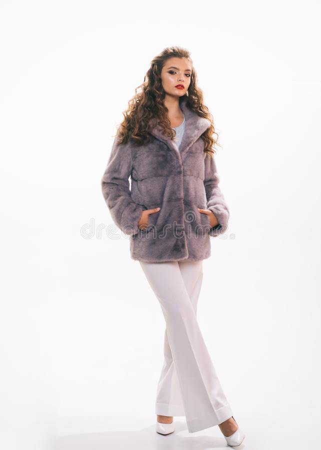 When fashion meets aesthetic beauty. Fashion model wear luxurious fur. Pretty woman in fashionable fur coat. Winter. Fashion trends. Young woman wear elegant stock photo