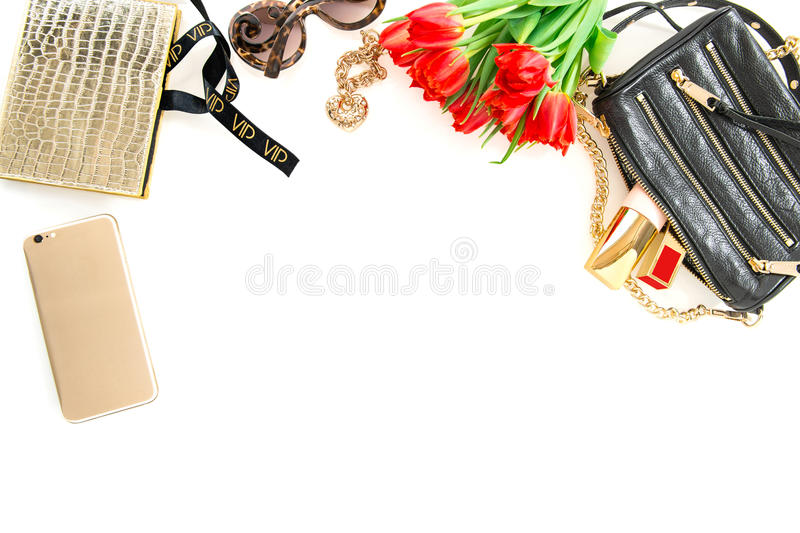 Fashion mock up with accessories, flowers, cosmetics. Online shop royalty free stock photo