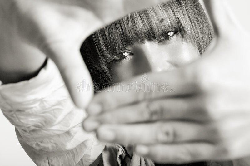 Fashion Model. Vision to the world beyond - fashion model with hands in front of face small DOF royalty free stock photo