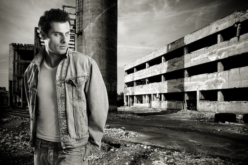 Fashion Model. Handsome fashion model shot at an old romanian abandoned factory stock images