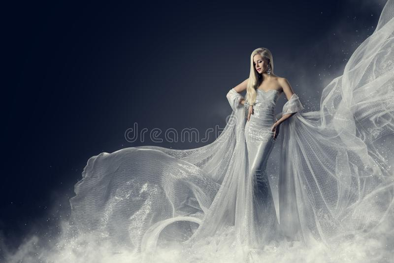 Fashion Model Beauty Dress, Waving Silver Cloth Gown, Woman stock photo