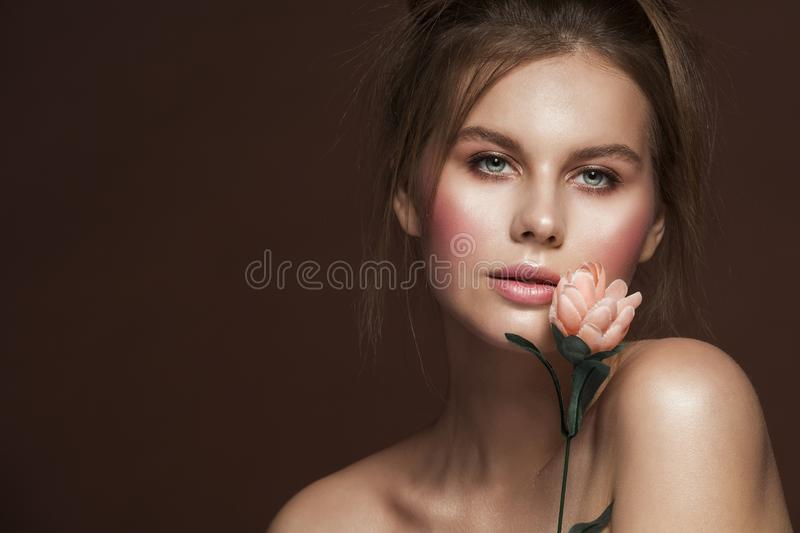 Fashion Model Beauty Makeup Dishevel Hairstyle with Flower, Beautiful Woman Studio Portrait. Girl looking at camera stock images