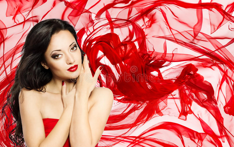 Fashion Model Beauty Portrait, Woman over Red Waving Silk Cloth stock photo