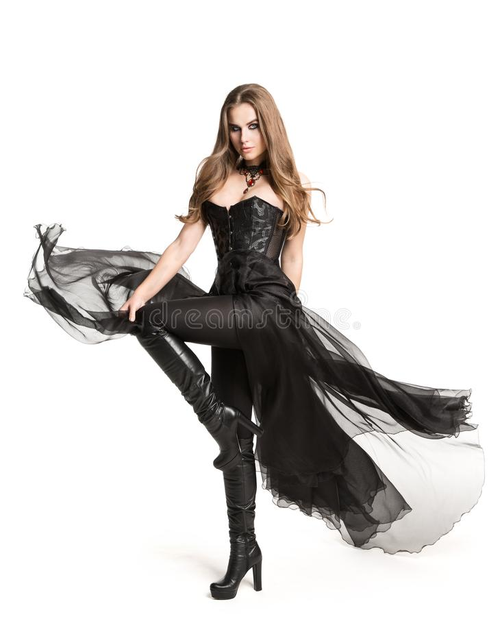 Fashion Model Black Corset Dress Leather Boots, Beautiful Woman in Gothic Gown, White stock images
